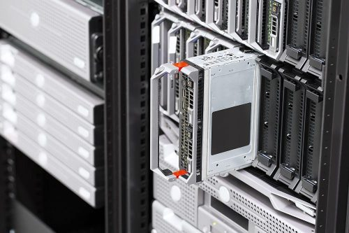 Installation of blade servers in a enterprise data center. Racks with servers and backup drives.